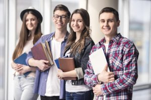 Young people holding books
